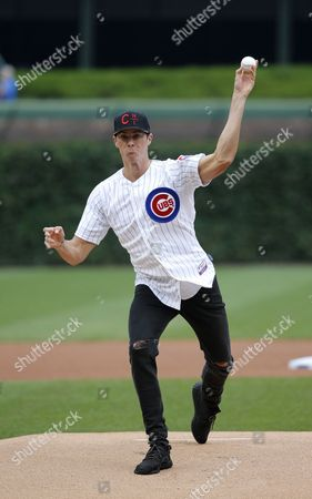 Conor Dwyer Olympic swimmer and Gold Medalist Conor Dwyer throws out a ceremonial first pitch before a baseball game between the Chicago Cubs and the St. Louis Cardinals, in Chicago