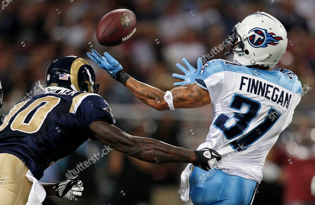 Cortland Finnegan, Mike Sims-Walker Tennessee Titans cornerback Cortland Finnegan, right, reaches for a tipped pass intended for St. Louis Rams wide receiver Mike Sims-Walker during the first quarter of an NFL football game, in St. Louis. After the pass was tipped, it was intercepted by the Titans' Alterraun Verner and returned 15 yards