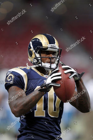 St. Louis Rams wide receiver Mike Sims-Walker catches a pass while warming up before the start of an NFL football game against the Tennessee Titans, in St. Louis