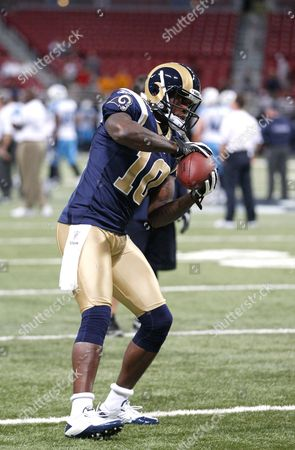 St. Louis Rams wide receiver Mike Sims-Walker catches a pass before the start of an NFL football game against the Tennessee Titans, in St. Louis