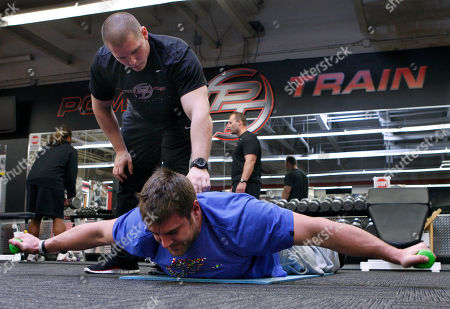 Bob Thompson, Todd Herremans In this photograph taken, trainer Bob Thompson, left, watches as Philadelphia Eagles offensive lineman Todd Herremans works out with a pair of 3-pound, fluorescent green dumbbells at Power Train Sports Institute in Cherry Hill, N..J