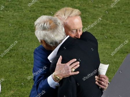 Vin Scully, Sandy Koufax Los Angeles Dodgers Hall of Fame broadcaster Vin Scully, top right, embraces Dodger Hall of Fame pitcher Sandy Koufax as Scully is honored in a pregame ceremony before a baseball game against the Colorado Rockies at Dodger Stadium