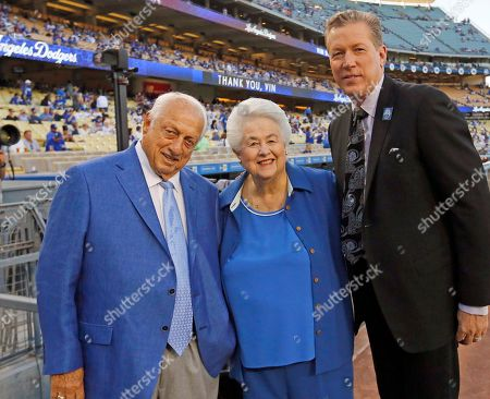 Vin Scully, Roz Wyman, Orel Hershiser Former Los Angeles Dodgers manager Tommy Lasorda, left, Roz Wyman, the youngest person and the second woman to serve on the Los Angeles City Council, who in the 1950's campaigned on getting major-league baseball to L.A., and former Dodgers pitcher and current broadcaster Orel Hershiser pose for a photo before Los Angeles Dodgers Hall of Fame broadcaster Vin Scully is honored in a pregame ceremony at Dodger Stadium