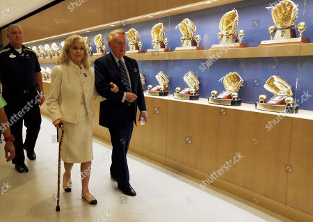 Vin Scully, Sandra Hunt Scully Los Angeles Dodgers Hall of Fame broadcaster Vin Scully, right, and his wife Sandra Hunt Scully walk past a display of Dodger award as they head for a ceremony where Vin Scully was to be honored before a baseball game against the Colorado Rockies at Dodger Stadium