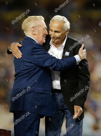 Vin Scully, Sandy Koufax Hall of Fame Los Angeles Dodgers broadcaster Vin Scully, left, hugs Sandy Koufax during Vin Scully Appreciation Day before the team's baseball game against the Colorado Rockies, in Los Angeles. Scully's final game at Dodger Stadium will be Sunday