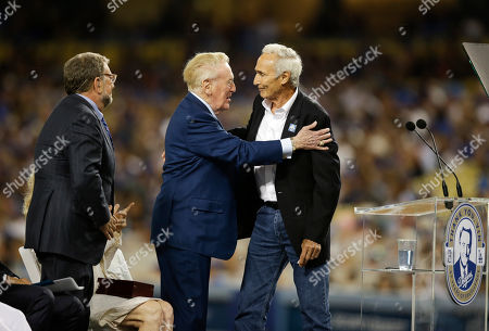 Vin Scully, Sandy Koufax Hall of Fame Los Angeles Dodgers broadcaster Vin Scully hugs Sandy Koufax during Vin Scully Appreciation Day before the team's baseball game against the Colorado Rockies, in Los Angeles. Scully's final game at Dodger Stadium will be Sunday against the Rockies