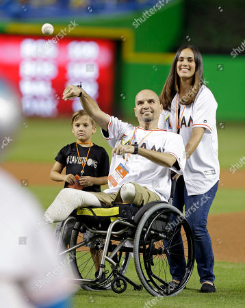 Javier Perez Javier Perez, principal of South Dade High School, throws the ceremonial first pitch of a baseball game between the Atlanta Braves and the Miami Marlins, in Miami
