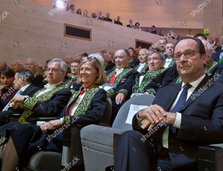 France's President Francois Hollande, left, sits among members of the academy of science at the World Science Day a gathering of scientists from 57 countries at the Louvre museum in Paris, . France is also celebrating 350 years of it's academy of science. President of France academy of science Bernard Meunier, left, and Pascale Cossart, center
