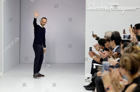 Stock Photo of Fashion designer Fulvio Rigoni acknowledges the applause of the audience after presenting Salvatore Ferragamo women's Spring-Summer 2017 collection, part of the Milan Fashion Week, unveiled in Milan, Italy