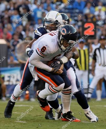 Jay Cutler, Donald Strickland San Diego Chargers' Donald Strickland, behind, pulls Chicago Bears quarterback Jay Cutler to the ground for a sack during the first half of an NFL preseason football game, in San Diego