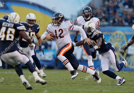 Donald Strickland, Caleb Hanie Chicago Bears quarterback Caleb Hanie, center, looks for open receiver as San Diego Chargers cornerback Donald Strickland, right, pursues during the first half of an NFL preseason football game, in San Diego