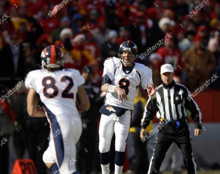 Kyle Orton, Dan Gronkowski Denver Broncos quarterback Kyle Orton (8) passes to tight end Dan Gronkowski (82) during the first half of an NFL football game against the Kansas City Chiefs at Arrowhead Stadium in Kansas City, Mo