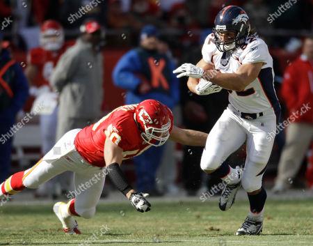 Mike Vrabel, Dan Gronkowski Denver Broncos tight end Dan Gronkowski (82) gets past Kansas City Chiefs linebacker Mike Vrabel (50) during the first half of an NFL football game against the Kansas City Chiefs at Arrowhead Stadium in Kansas City, Mo