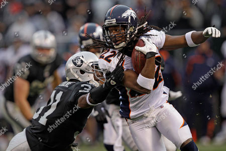 Syd'Quan Thompson Hiram Eugene Denver Broncos cornerback Syd'Quan Thompson (22) and Oakland Raiders safety Hiram Eugene (31) in action during the second quarter of an NFL football game in Oakland, Calif