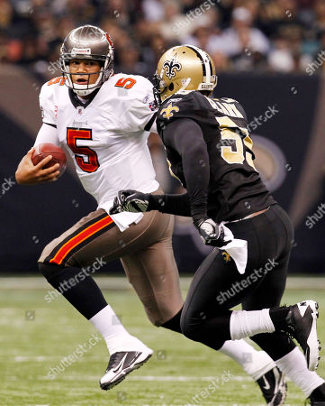 Josh Freeman Tampa Bay Buccaneers quarterback Josh Freeman (5) is pursued by New Orleans Saints linebacker Danny Clark (55) during the first quarter of an NFL football game at the Louisiana Superdome in New Orleans