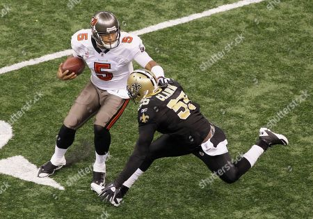 Stock Photo of Josh Freeman, Danny Clark Tampa Bay Buccaneers quarterback Josh Freeman (5) tries to avoid New Orleans Saints linebacker Danny Clark (55) during an NFL football game at the Louisiana Superdome in New Orleans
