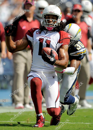 Larry Fitzgerald, Donald Strickland Arizona Cardinals wide receiver Larry Fitzgerald is tackled by San Diego Chargers defensive back Donald Strickland first half of an NFL football game, in San Diego