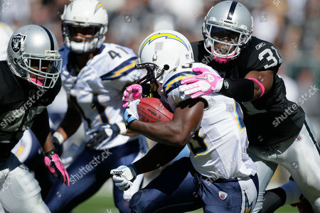 Darren Sproles, Hiram Eugene San Diego Chargers running back Darren Sproles (43) is tackled by Oakland Raiders safety Hiram Eugene (31) in an NFL football game in Oakland, Calif