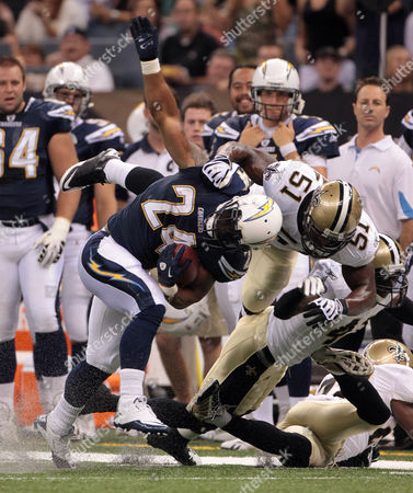 Ryan Matthews, Jonathan Vilma San Diego Chargers running back Ryan Mathews (24) is taken down by New Orleans Saints defender Jonathan Vilma (51) in the first quarter of their preseason NFL football game at the Louisiana Superdome in New Orleans