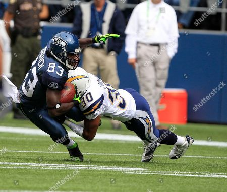 Deion Branch, Donald Strickland Seattle Seahawks' Deion Branch is tackled by San Diego Chargers' Donald Strickland in the first half of an NFL football game, in Seattle