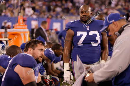 Stock Photo of Shawn Andrews New York Giants' Shawn Andrews, right, on the sidelines during the fourth quarter of an NFL football game between the New York Giants and the Dallas Cowboys at New Meadowlands Stadium, in East Rutherford, N.J. The Cowboys won the game 33-20
