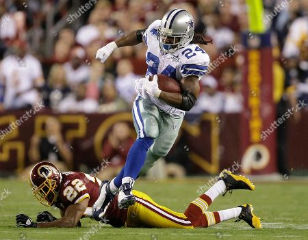 Stock Photo of Marion Barber, Carlos Rogers Dallas Cowboys running back Marion Barber breaks a tackle from Washington Redskins cornerback Carlos Rogers during the first half of an NFL football game in Landover, Md., on
