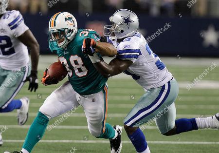 Leon Williams, Jamar Wall, Patrick Cobbs Miami Dolphins running back Patrick Cobbs (38) Dallas Cowboys linebacker Leon Williams (52) and cornerback Jamar Wall, right, during a preseason NFL football game, in Arlington, Texas