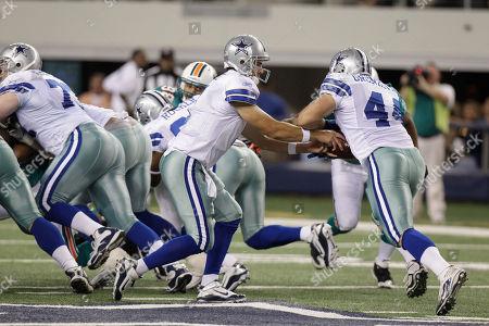 Chris Gronkowski, Stephen McGee Dallas Cowboys quarterback Stephen McGee (7) hands off to running back Chris Gronkowski (44) during a preseason NFL football game against the Miami Dolphins, in Arlington, Texas