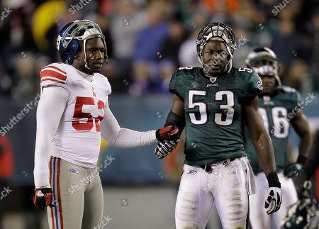 Stock Image of Clint Sintim, Moise Fokou New York Giants linebacker Clint Sintim, left, and Philadelphia Eagles linebacker Moise Fokou (53) during the second half of an NFL football game in Philadelphia
