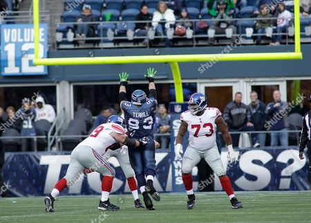 Craig Terrill Seattle Seahawks' Craig Terrill tries to block a New York Giants pass as Giants' Rich Seubert, left, and Shawn Andrews, right, look on in the second half of an NFL football game, in Seattle