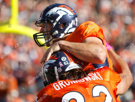 Tim Tebow, Dan Gronkowski Denver Broncos quarterback Tim Tebow (15) celebrates his first NFL touchdown with tight end Dan Gronkowski (82) during the second half of an NFL football game, in Denver. The Jets won 24-20