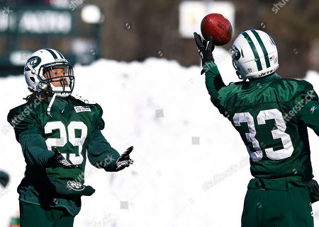Eric Smith, Isaiah Trufant New York Jets safety Eric Smith (33) grabs the ball in front of defensive back Isaiah Trufant (29) during practice, in Florham Park, N.J. The Jets play the New England Patriots in the AFC Divisional playoff game Sunday