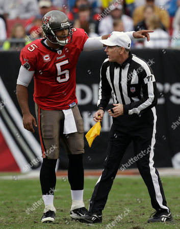 Terry McAulay, Josh Freeman Tampa Bay Buccaneers quarterback Josh Freeman (5) argues with referee Terry McAulay during an NFL football game against the Detroit Lions, in Tampa, Fla
