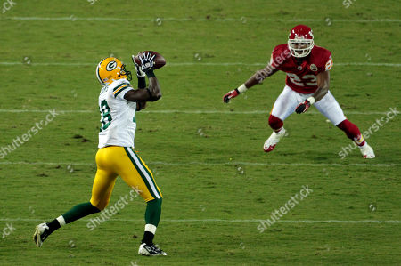 Patrick Williams Green Bay Packers wide receiver Patrick Williams (18) catches a pass under pressure from Kansas City Chiefs cornerback Mike Richardson (23) during the second quarter of a preseason NFL football game in Kansas City, Mo