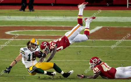 Brett Swain Green Bay Packers wide receiver Brett Swain (16) is tackled by Kansas City Chiefs defensive back Javier Arenas (30) and defensive back Kendrick Lewis (49) after completing a pass for 14 yards during the second quarter of a preseason NFL football game, in Kansas City, Mo