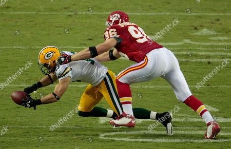 Brett Swain Green Bay Packers wide receiver Brett Swain, left, is tackled by Kansas City Chiefs linebacker Andy Studebaker (96) after catching a pass for a short gain during the first quarter of a preseason NFL football game, in Kansas City, Mo