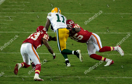 Green Bay Packers wide receiver Chastin West (11) is tackled by Kansas City Chiefs cornerback Mike Richardson (23) and safety Ricky Price (35) during the second quarter of a preseason NFL football game in Kansas City, Mo