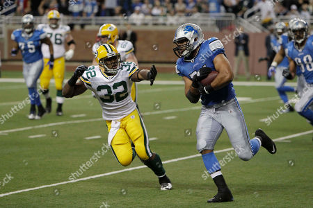 DeAndre Levy, Brandon Jackson Detroit Lions linebacker DeAndre Levy is pulled down by Green Bay Packers running back Brandon Jackson (32) after an interception during the third quarter of an NFL football game at Ford Field in Detroit