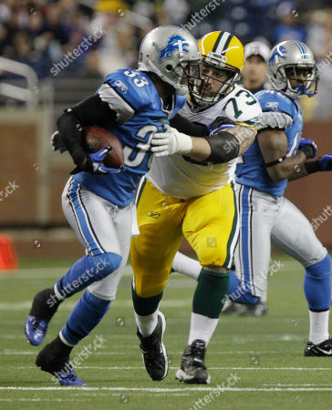 Daryn Colledge, Brandon McDonald Detroit Lions cornerback Brandon McDonald (33) is stopped by Green Bay Packers guard Daryn Colledge (73)during the first quarter of an NFL football game against the Green Bay Packers at Ford Field in Detroit