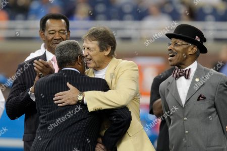 Dick LeBeau, Lem Barney Detroit Lions Pro Football Hall of Fame cornerback Dick LeBeau stands with Lem Barney, right, and Charlie Sanders, left, att midfield during a ceremony at Ford Field in Detroit, . The Lions honored LeBeau during the team's halftime Alumni Day festivities