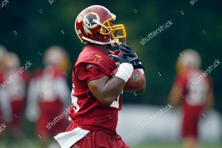 Stock Picture of Chris Draft Washington Redskins linebacker Chris Draft catches the ball during the last day of their NFL football training camp at Redskins Park in Ashburn, Va