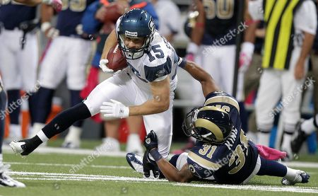Seattle Seahawks wide receiver Isaiah Stanback (15) runs with the ball after catching a pass against St. Louis Rams cornerback Justin King (31) during the first quarter of an NFL football game, in St. Louis