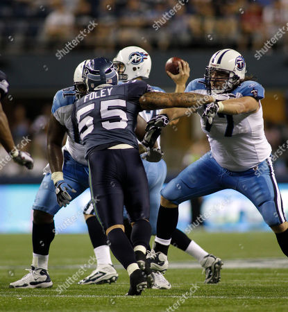 Stock Photo of Ricky Foley, Ryan Durand Seattle Seahawks' Ricky Foley (55) blocks Tennessee Titans' Ryan Durand, right, in the second half of an NFL preseason football game, in Seattle