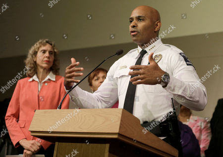 Jennifer Roberts, Kerr Putney Charlotte-Mecklenburg Police chief Kerr Putney, right, gestures as Charlotte mayor Jennifer Roberts, left, watches in Charlotte, N.C. during a news conference concerning protests and the investigation into Tuesday's fatal police shooting of Keith Lamont Scott