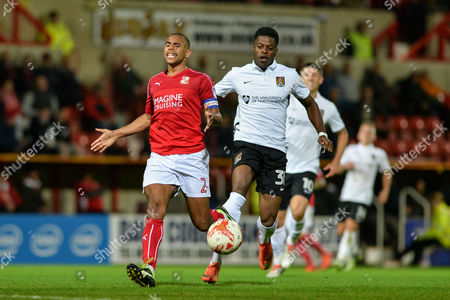 Swindon Town Defender, Nathan Thompson (2) holds of Northampton Town Forward, JJ Hooper (30) during the EFL Sky Bet League 1 match between Swindon Town and Northampton Town at the County Ground, Swindon