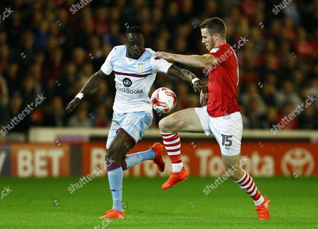 Aly Cissokho of Aston Villa and Marley Watkins of Barnsley during the Sky Bet Championship match between Barnsley and Aston Villa played at Oakwell Stadium, Barnsley on 27th September 2016
