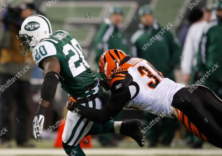 Kyries Hebert, Thomas Jones Cincinnati Bengals safety Kyries Hebert (34) tackles New York Jets running back Thomas Jones (20) during the second quarter of an NFL football game at Giants Stadium in East Rutherford, N.J