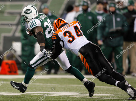 Thomas Jones Kyries Hebert New York Jets running back Thomas Jones (20) is tackled by Cincinnati Bengals safety Kyries Hebert (34) during the second quarter of an NFL football game at Giants Stadium in East Rutherford, N.J