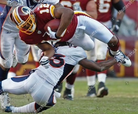 Malcolm Kelly, Renaldo Hill Washington Redskins wide receiver Malcolm Kelly is upended by Denver Broncos safety Renaldo Hill during the NFL football game, in Landover, Md