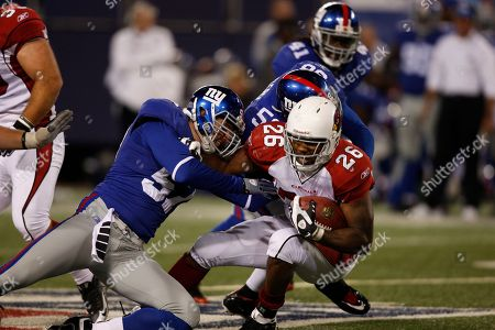 Beanie Wells Arizona Cardinals running back Beanie Wells (26) is tackled by New York Giants linebacker Chase Blackburn (57) and teammate Antonio Pierce (58) during the fourth quarter of an NFL football game, in East Rutherford, N.J